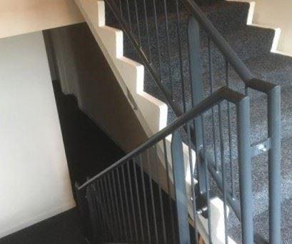Traphekwerk met trapleuningen